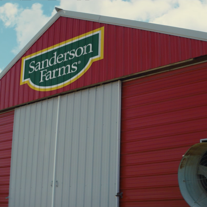 Sanderson Farms logo on barn